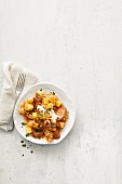 Pork goulash with sauerkraut, potatoes and sour cream