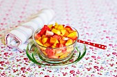 Fruit salad made from persimmons, strawberries, nectarines and sesame cream
