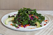 Kale salad with hemp seeds, peppers, red cabbage, carrots, avocado and a lemon and garlic vinaigrette