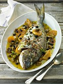 Gilthead seabream with olives and lemon confit