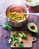 Mexican tortilla soup with sweetcorn, avocado and fresh coriander