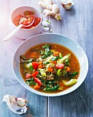 Spinach and lentil soup with leek, tomatoes and carrots