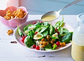 Spinach salad with Gorgonzola, redcurrants, walnuts and a poppyseed dressing