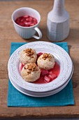 Strawberry-Amarettini dumplings in rhubarb sauce