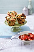 Mushroom dumpling muffins with spring onions served with a tomato sauce with capers