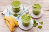 Green smoothies for kids made from bananas, apples, spinach and agave syrup