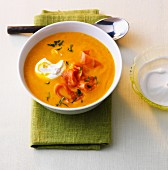 Pumpkin curry soup with smoked salmon and sour cream