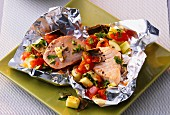 A duo of fine fish with Mediterranean vegetables in aluminium foil