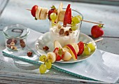 Fruit skewers with a lemon dip and hazelnuts