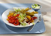 Fried potatoes with caramelised chicory, red peppers and spring onions