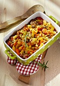 Red pasta bake with minced meat and brown lentils