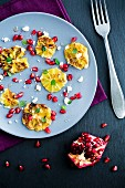 Grilled orange slices with mint, pomegranate and goat's cheese