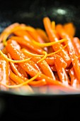 Carrots with orange glaze and candied pine nuts