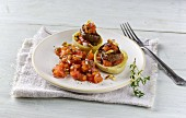 Lamb fillet in stuffed artichoke hearts with tomato salsa