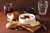 Baked Camembert with almonds and cranberry sauce
