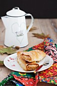 A mini apple and pumpkin strudel served with coffee