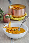 Pumpkin and apple soup with roasted carrots and pumpkin seeds