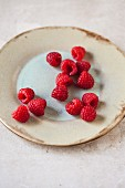 Fresh raspberries on a ceramic plate
