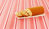 A strawberry cream Swiss roll, sliced