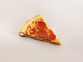 A slice of stuffed crust pizza with pepperoni