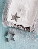 A cut-out white sugar star