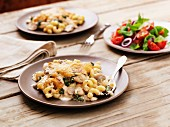 Oven-baked chicken with pasta and a mushroom and cheese sauce