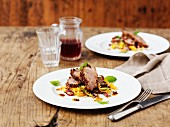 Roast shoulder of lamb with citrus fruits and a couscous and mint salad