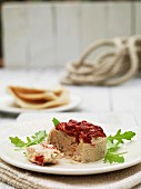 Tuna terrine with roasted peppers, pita bread and rocket