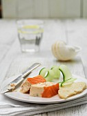 Salmon terrine with sponge cake and cucumber strips