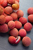 Lychees on grey fabric