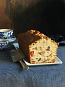 Sliced fruit and nut cake served with tea