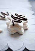 White marshmallow stars decorated with chocolate