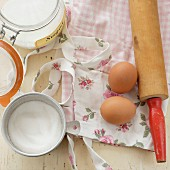 Baking ingredients and a rose-patterned apron