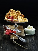 Heart waffles with strawberry jam and whipped cream
