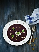 Blueberry soup with pistachio nuts