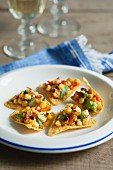 Tortilla chips with a sweetcorn and avocado salsa