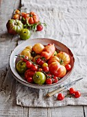Various types of tomatoes in a ceramic bowl