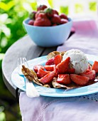 Crepes with fresh strawberries and ice cream