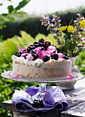 Meringue cake with cherries and rose petals