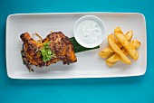 Chilli chicken with herb sauce and chips
