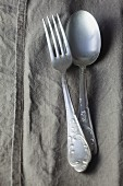 Silver cutlery on a linen napkin