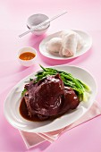 Braised pork knuckle with steamed rolls