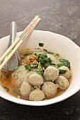 Noodle soup with meatballs and coriander