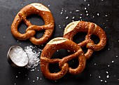Three salted lye pretzels with coarse sea salt