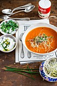 Cream of tomato soup with cream cheese and bean sprouts