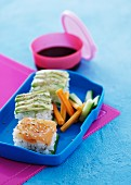 Rice appetisers with salmon and avocado in a lunch box