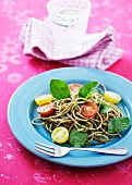 Wholemeal spaghetti with cherry tomatoes and basil