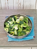 Broccoli florets in a steamer insert