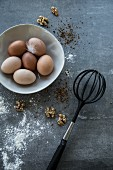Fresh eggs, walnuts and a whisk