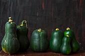 A row of green squash